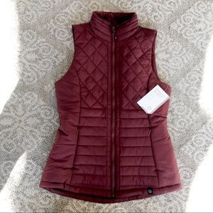 Maroon puffy vest with furry inside insulation